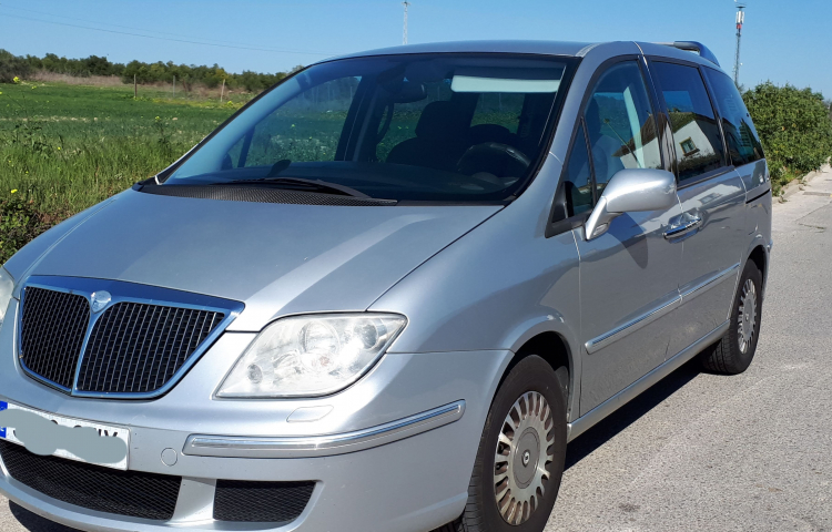 Hire a Lancia Phedra in Gines